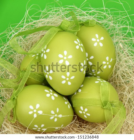 Colored egg with a pattern in the Easter basket - stock photo