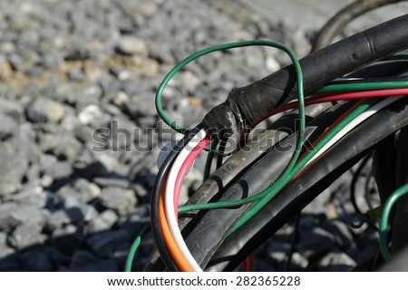 Colored electrical cables or wires old - stock photo