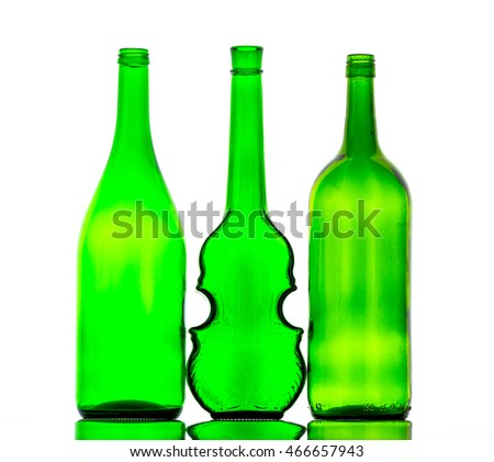 colored empty bottles on a white background