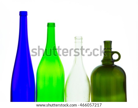 colored empty glass bottles for wine isolated on white background