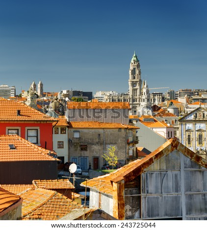 Colored facades and roofs of houses, view of the historic centre of Porto, Portugal. It was declared a World Heritage Site by UNESCO, and it is one of the most popular tourist destinations in Europe. - stock photo