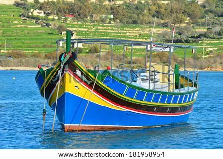 colored fishing boat,Malta island - stock photo