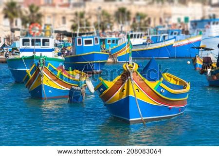 Colored Fishing boats in Marsaxlokk harbor, Malta - stock photo