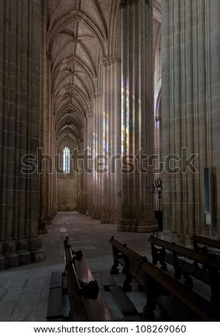 Colored flecks of sunlight on the columns of Batalha St. Maria da Vitoria Dominican abbey, Portugal - stock photo