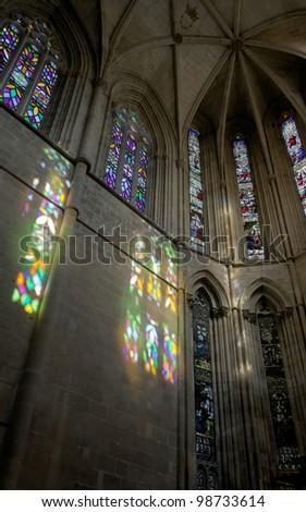 Colored flecks of sunlight on the walls of the Batalha-Santa Maria da Vitoria-Dominican abbey - Portugal - stock photo