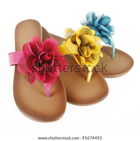 colored flip-flops with flowers - stock photo
