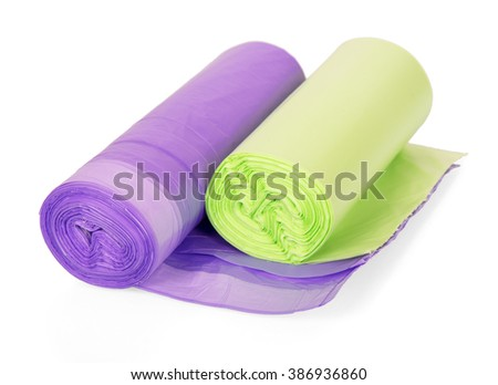 Colored garbage bags in rolls isolated on white background. - stock photo