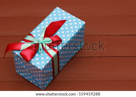 colored gifts presents on wooden background