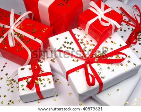 Colored gifts with shining stars - stock photo