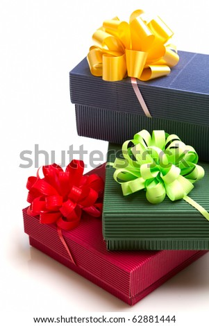 colored gifts with the ribbon isolated on white background