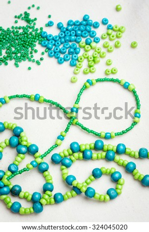Colored glass beads and thread beads