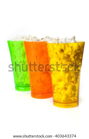 Colored glasses of popcorn isolated on a white background - stock photo