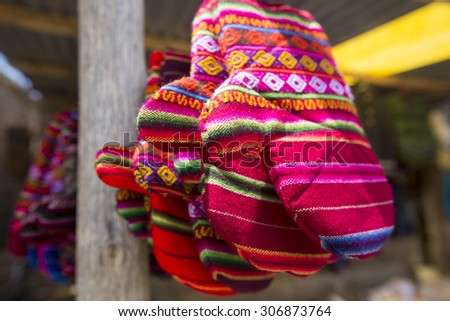 Colored gloves for Sale in Salar of Uyuni tourist market. Bolivia - stock photo