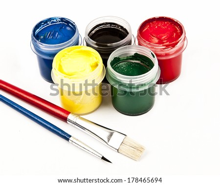 Colored gouache in jars with multicolored brushes isolated on white background  - stock photo