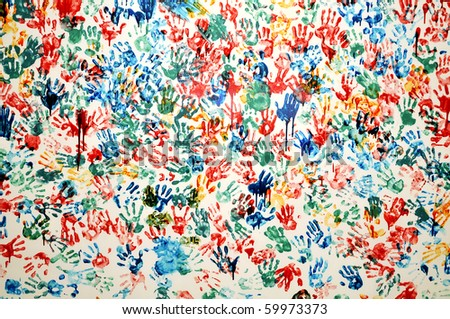 colored hand prints on white background - stock photo