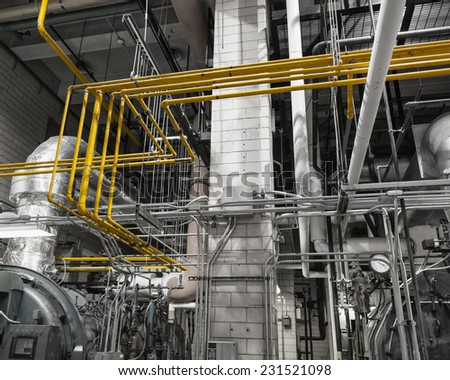 Colored heating and gas piping in a boiler plant.   - stock photo
