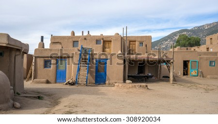 Colored houses in Taos Pueblo, NM