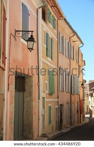 Colored houses in the village of Bedoin, France - stock photo