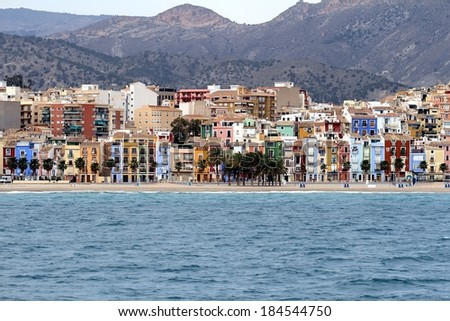 Colored houses of Villajoyosa town beach; the south coast of Benidorm city in Spain. - stock photo