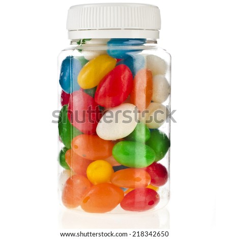 Colored JellyBeans in the plastic bottle  isolation on a white background