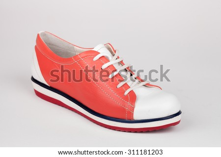colored leather shoe isolated on white background.