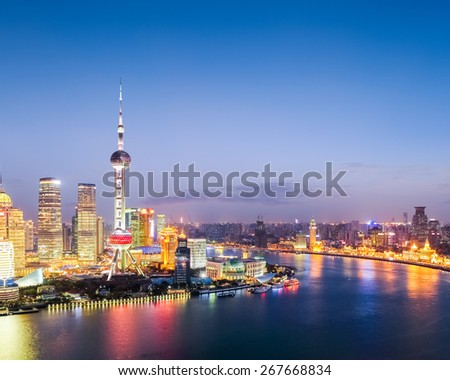 colored lights illuminate the shanghai when night falls - stock photo