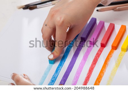 Colored lines painted pastel on white paper - stock photo