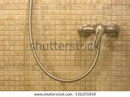 Colored mosaic background tiles in SPA. Shower head in luxury bathroom - stock photo