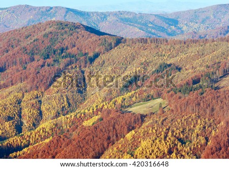 Colored mountain slopes in autumn Carpathian. Morning misty view.