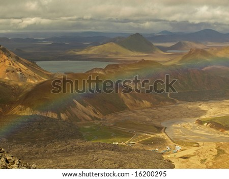 Colored mountains with rainbow in Landmannalaugar, Iceland - stock photo