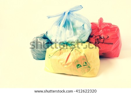 colored of garbage bags on white background - stock photo