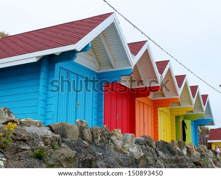 colored paint wooden Scarborough Victorian beach hut at the British seaside holiday