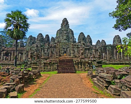 Colored Painting Temple Ruined Bayon in Siem Reap, Cambodia on Craquelure Texture - stock photo