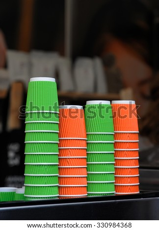 Colored paper cups for coffee - stock photo