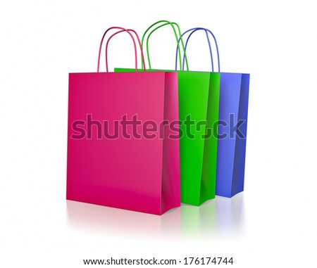 Colored paper shopping bags on white background - stock photo