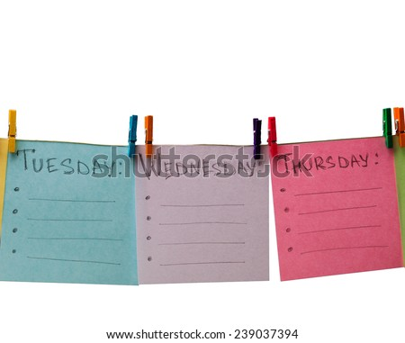 colored paper with days of week and color clothespegs - stock photo
