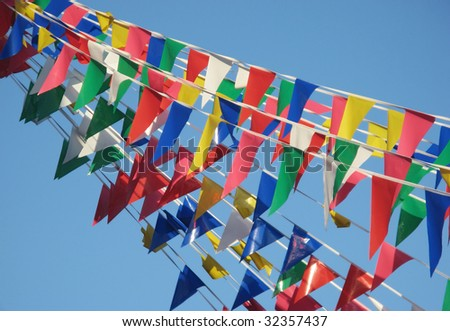 Colored party flags on blue sky