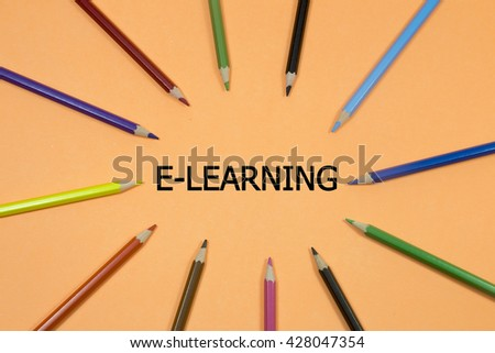 Colored Pen written showing to center with a word e-learning - stock photo