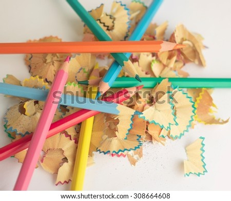 Colored pencil with colorful pencil shavings  - stock photo