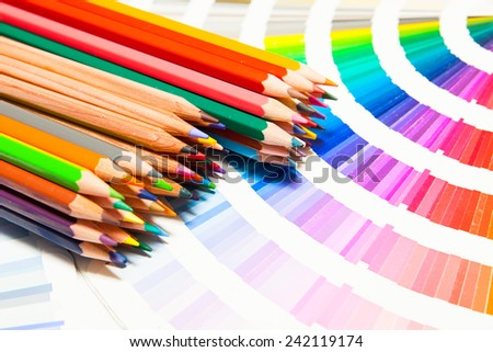 colored pencils and color chart of all colors - stock photo