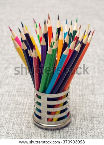 colored pencils are in a stand - stock photo