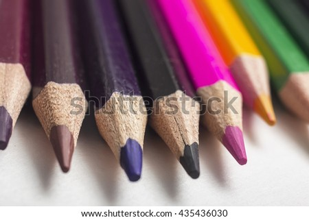Colored pencils close-up on a white background, for backgrounds and texture, close-up, shallow depth of field - stock photo