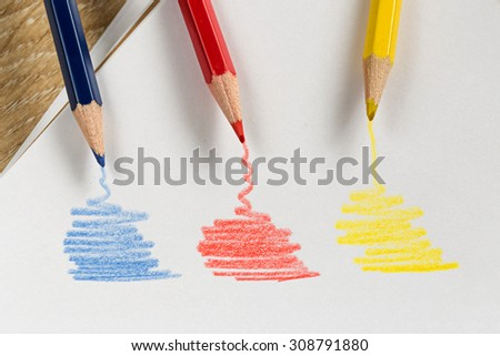 Colored pencils drawing on a white page.  - stock photo