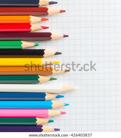 colored pencils for drawing on a notebook in the cage