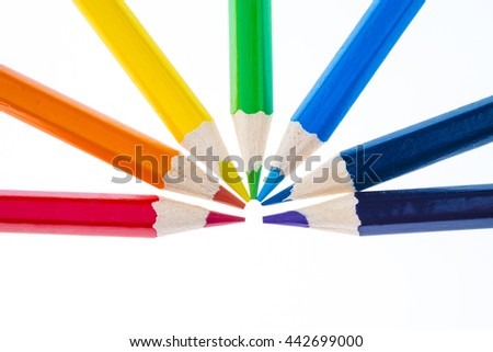 colored pencils forming a rainbow isolated on white