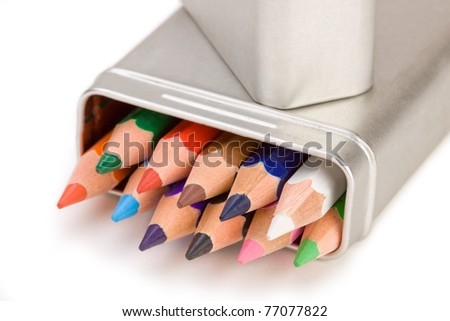 Colored pencils in a brushed aluminum case. - stock photo