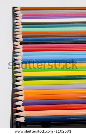 colored pencils in a line