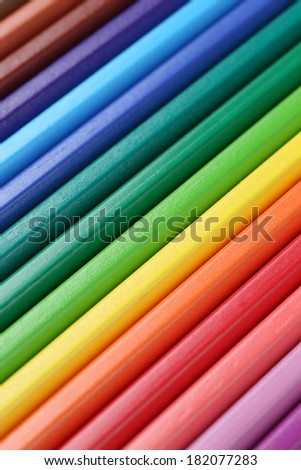 Colored pencils in a row forming a background back to school