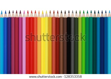 Colored pencils in a row, isolated on a white background - stock photo
