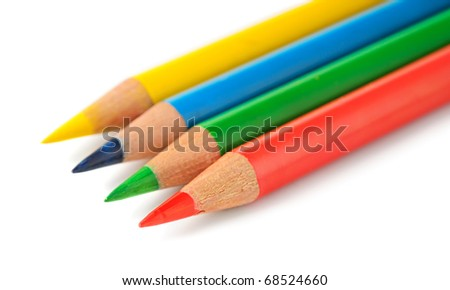 Colored pencils in a row isolated on white